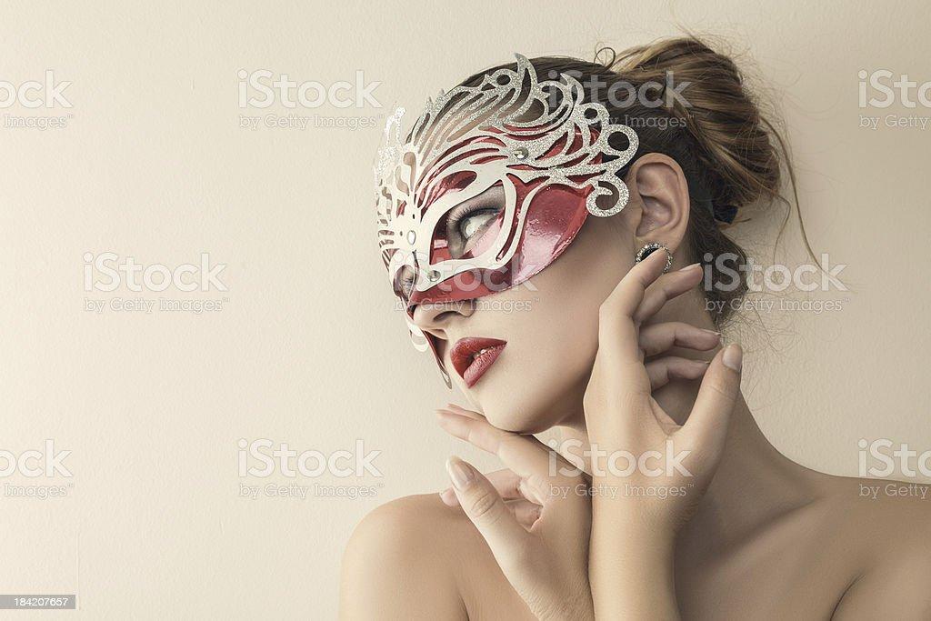 Beautiful young woman in venetian carnival mask royalty-free stock photo