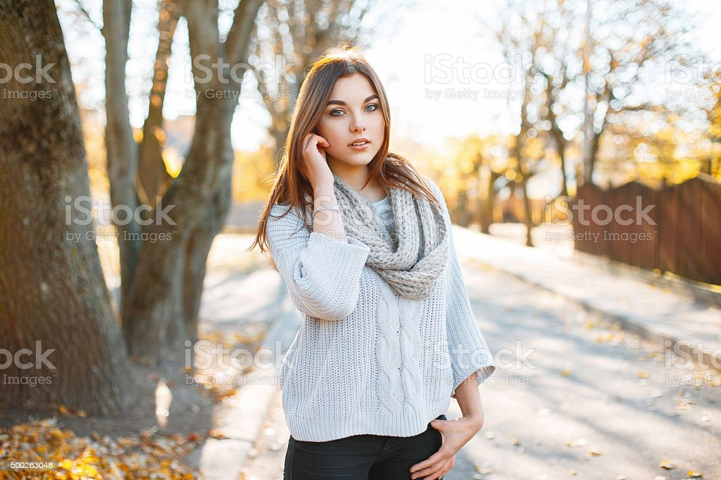 Beautiful young woman in vintage knitted sweater stock photo