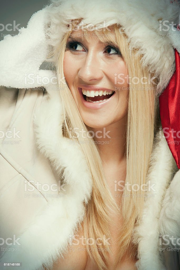 Beautiful young woman in warm clothes stock photo