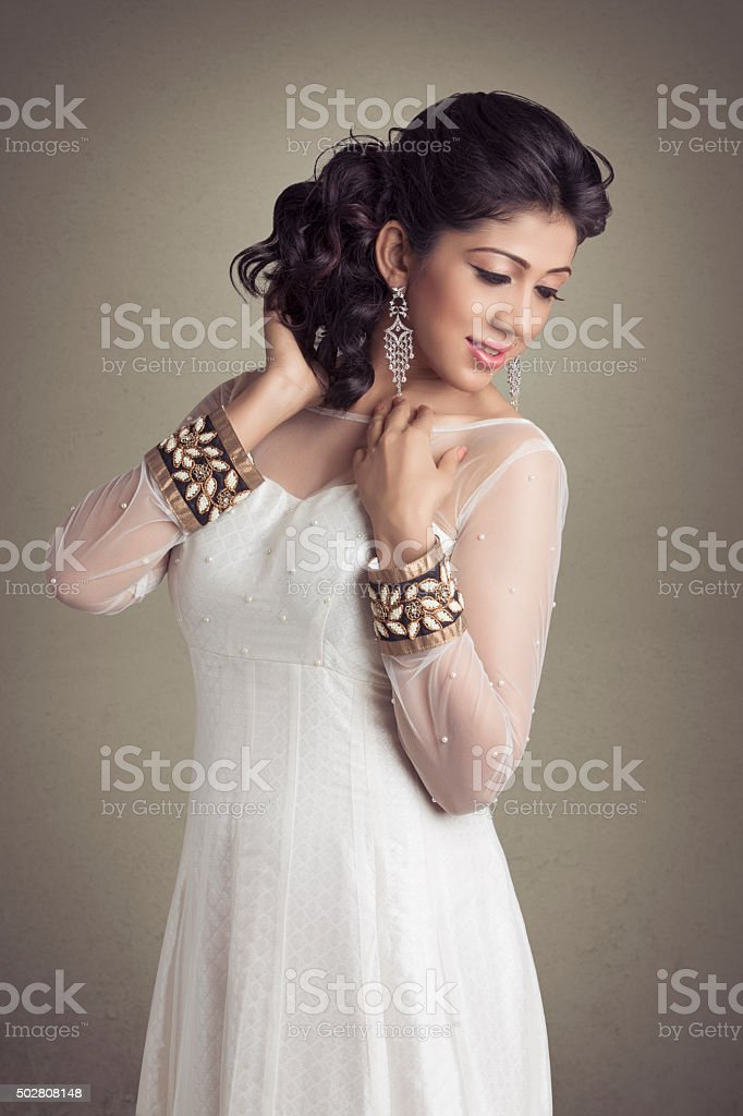 beautiful young woman in white party gown stock photo
