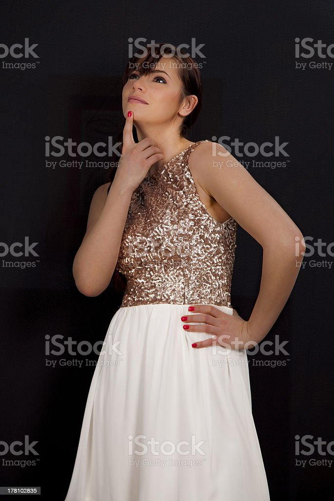 Beautiful young woman in white skirt reflecting royalty-free stock photo