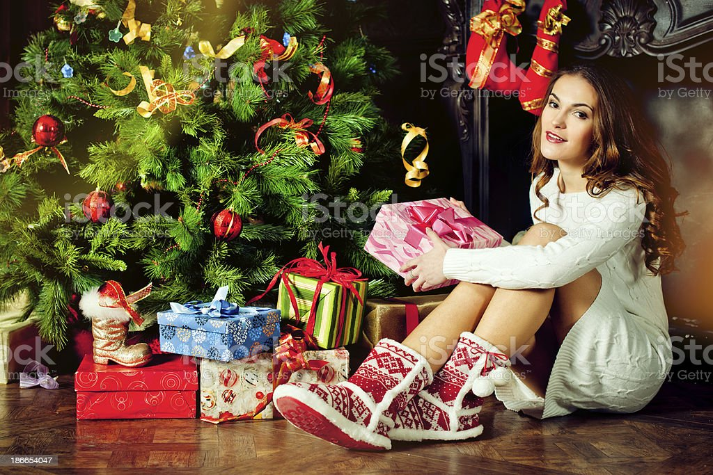 Beautiful young woman in Xmas Eve royalty-free stock photo