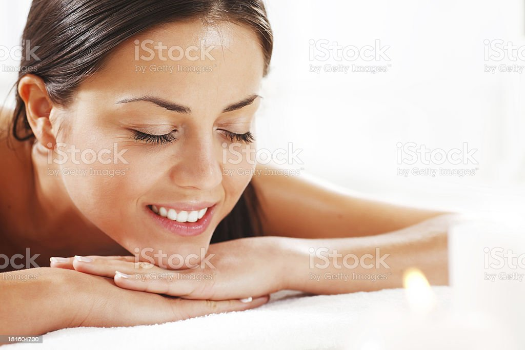 Beautiful young woman is relaxing at the spa centre. royalty-free stock photo