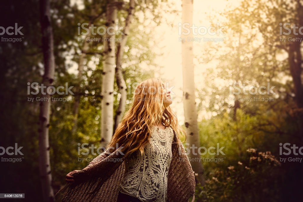 Beautiful Young Woman Joyful In Nature Forest Scenery stock photo