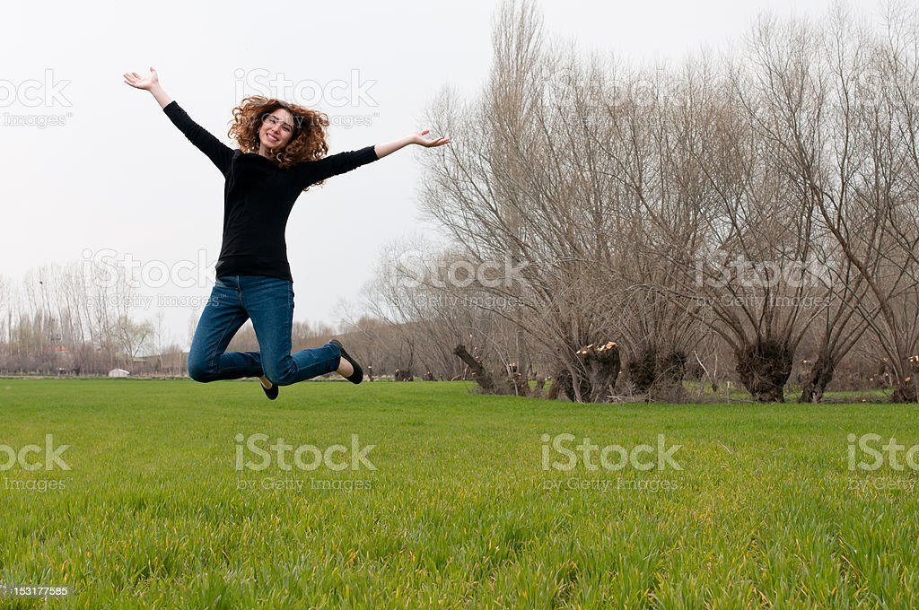 Beautiful young woman jumping royalty-free stock photo