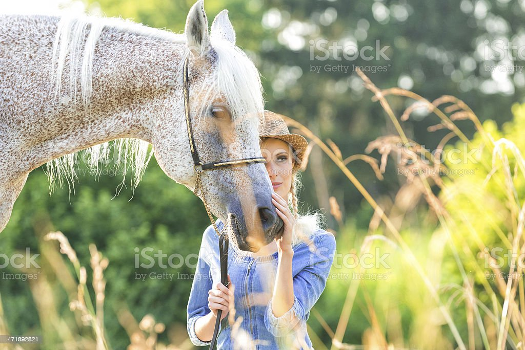 Beautiful Young woman leading Horse royalty-free stock photo