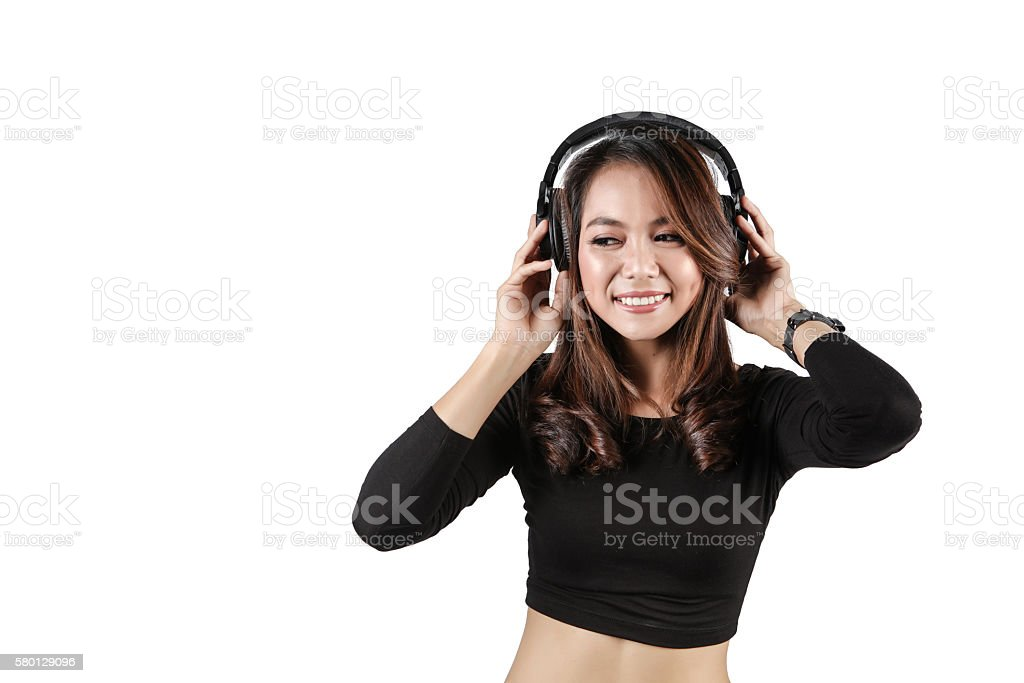 Beautiful young woman listening music in headphones stock photo