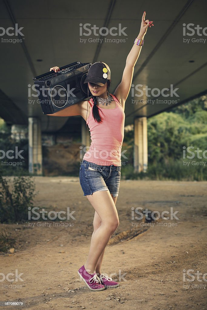 Beautiful young woman listening to music royalty-free stock photo