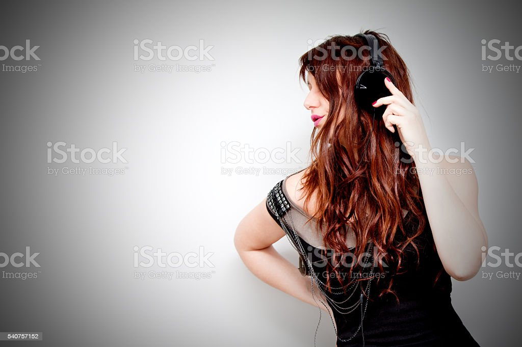 Beautiful young woman listening to music with headphones Lifestyle concept stock photo