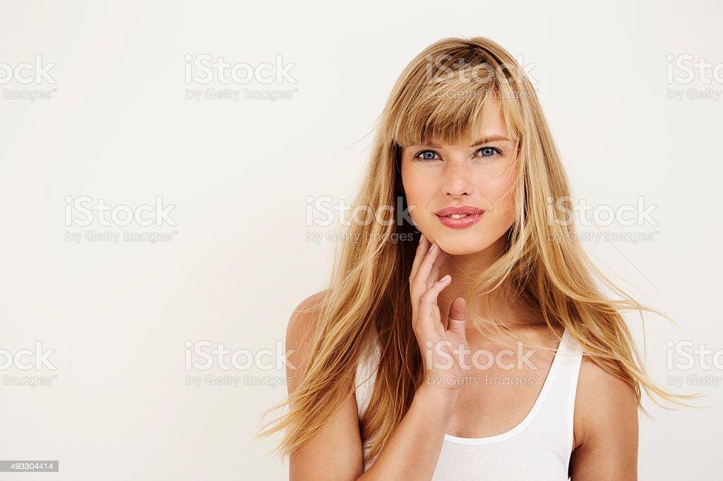 Beautiful young woman looking at camera stock photo
