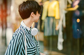 Beautiful Young Woman Looking At Shop Window In The City
