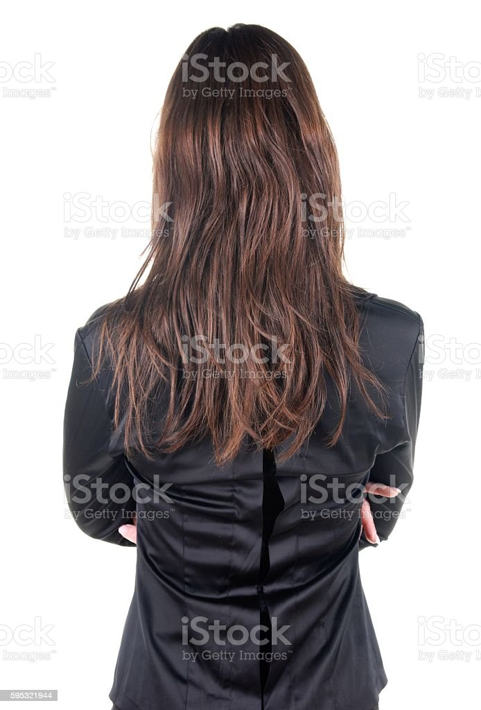 Beautiful young woman looking at wall. Rear view. stock photo