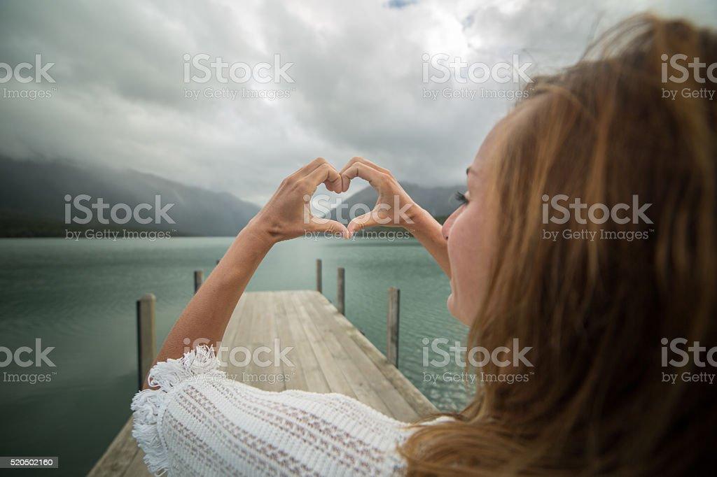 Beautiful young woman loving nature stock photo