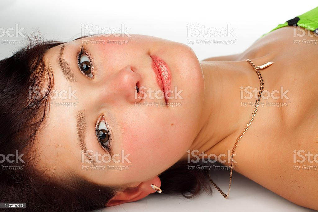 beautiful young woman lying on the floor royalty-free stock photo