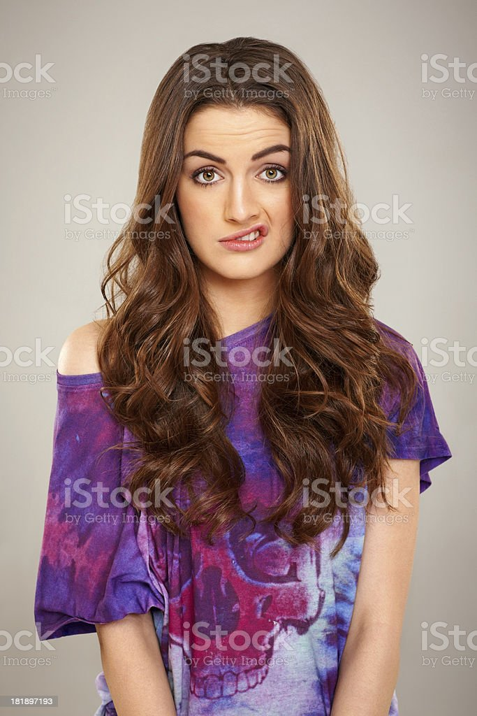 Beautiful young woman making a disgusted face royalty-free stock photo