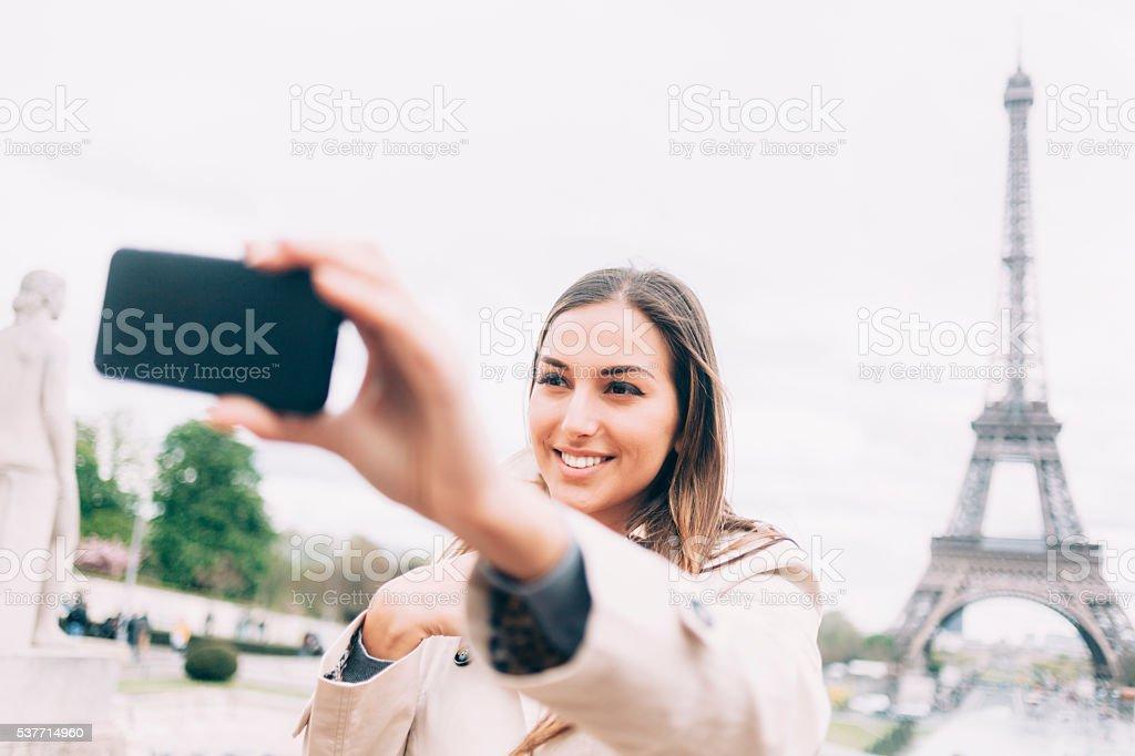 Beautiful young woman making selfie in Paris stock photo