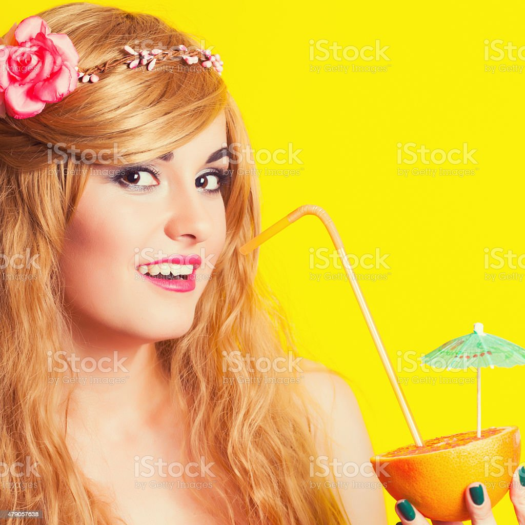 beautiful young woman making selfie using smartphone against yel stock photo