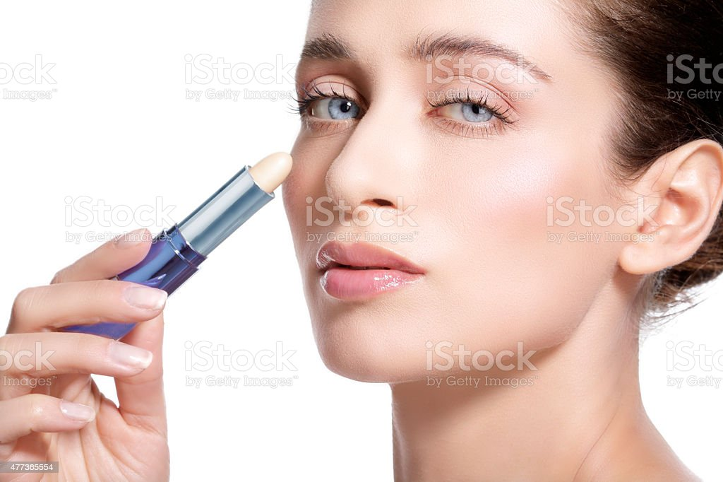 beautiful young woman model with perfect toned skin. Concealer stock photo