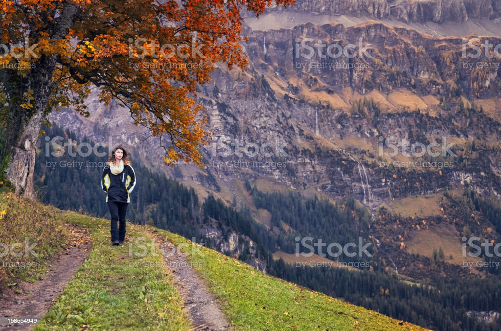 Beautiful young woman on Autumn walk in Switzerland stock photo