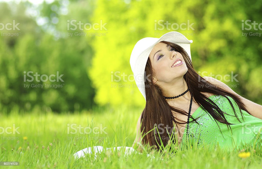 beautiful young woman on field in summer royalty-free stock photo