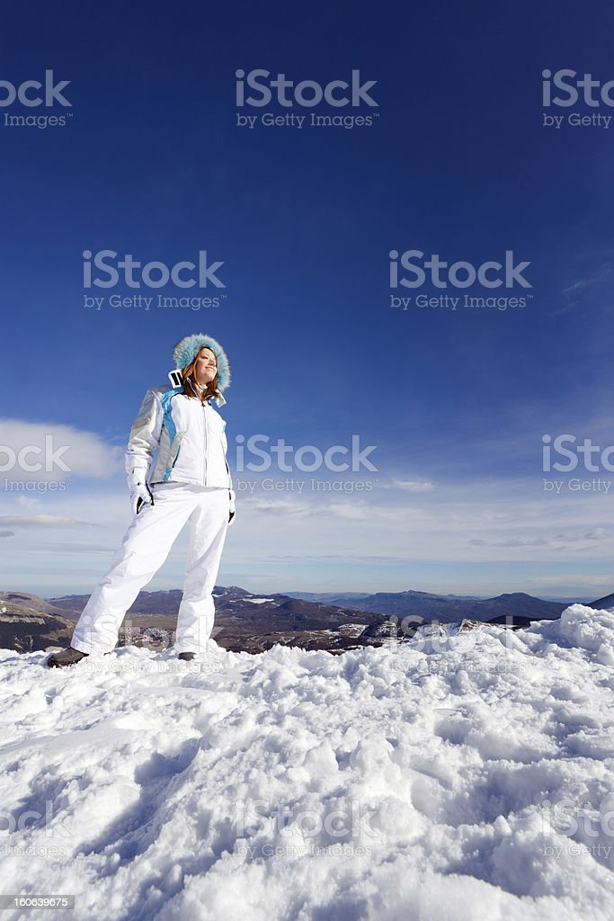Beautiful young woman on snowy mountain - XXXL royalty-free stock photo