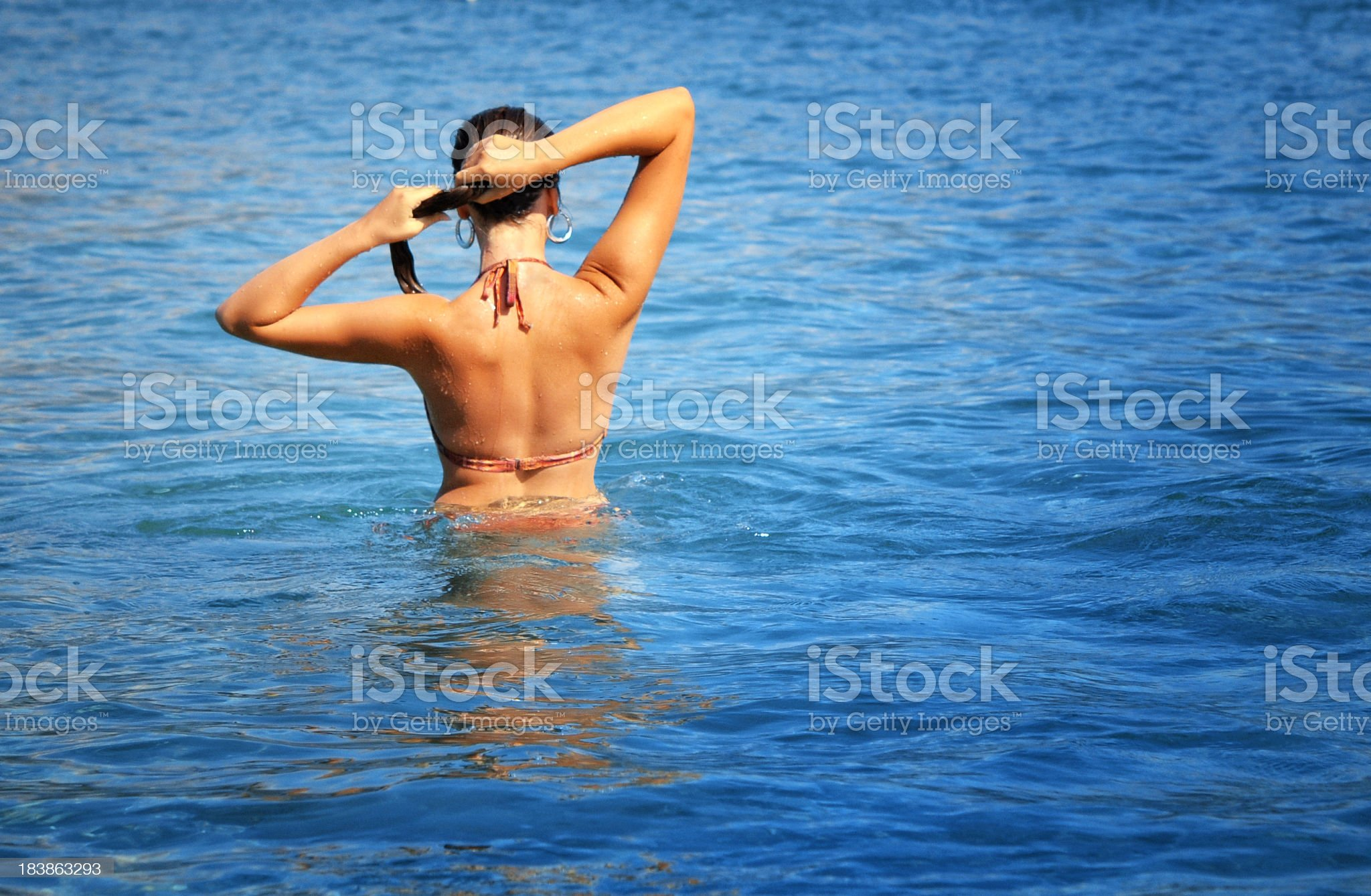 Beautiful young woman on the beach royalty-free stock photo