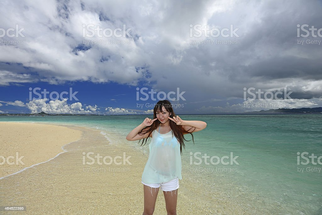 Beautiful young woman on the beach stock photo