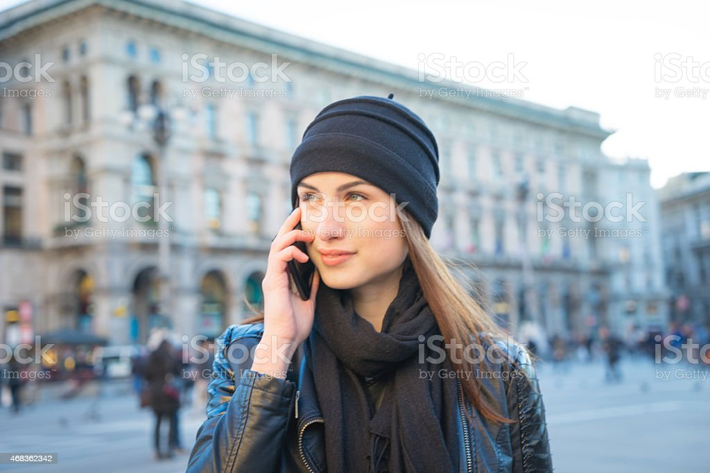 Beautiful Young Woman On The Phone In Urban Landscape stock photo