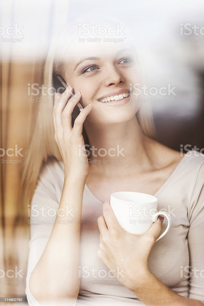 Beautiful young woman on the phone royalty-free stock photo