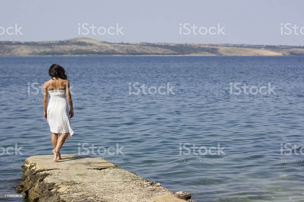 Beautiful young woman on the pier royalty-free stock photo