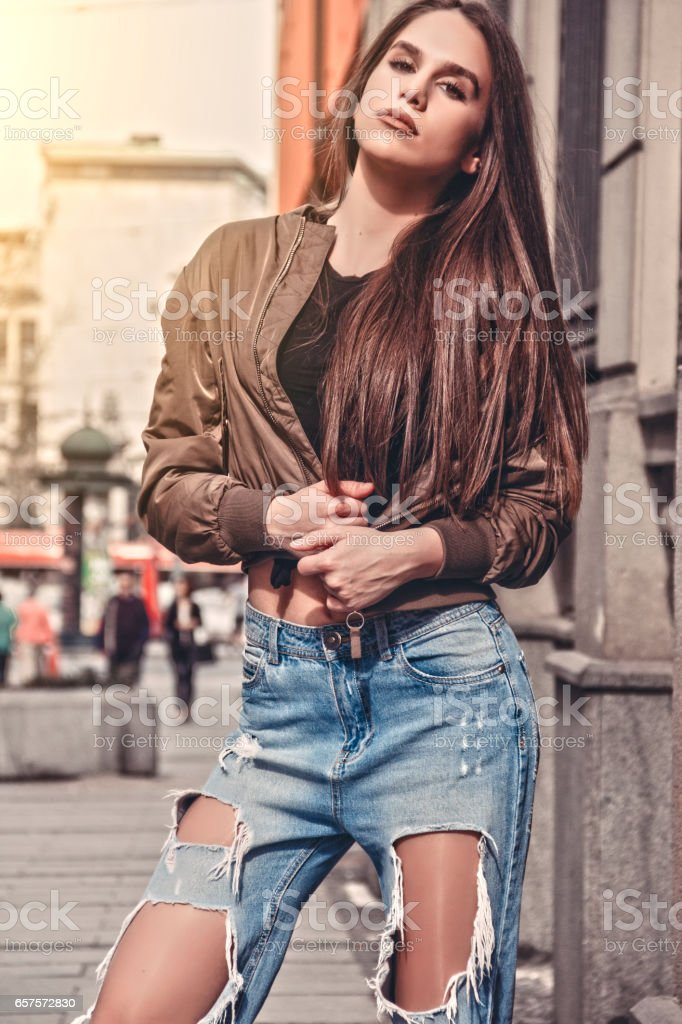 beautiful young woman on the street stock photo