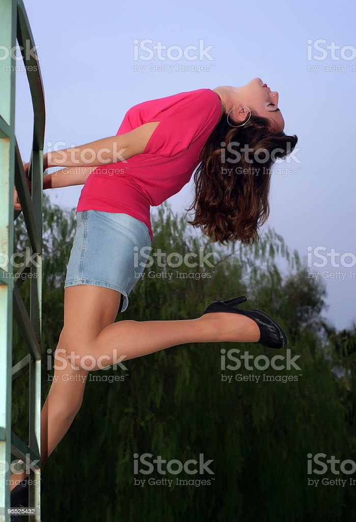 beautiful young woman on the wall royalty-free stock photo