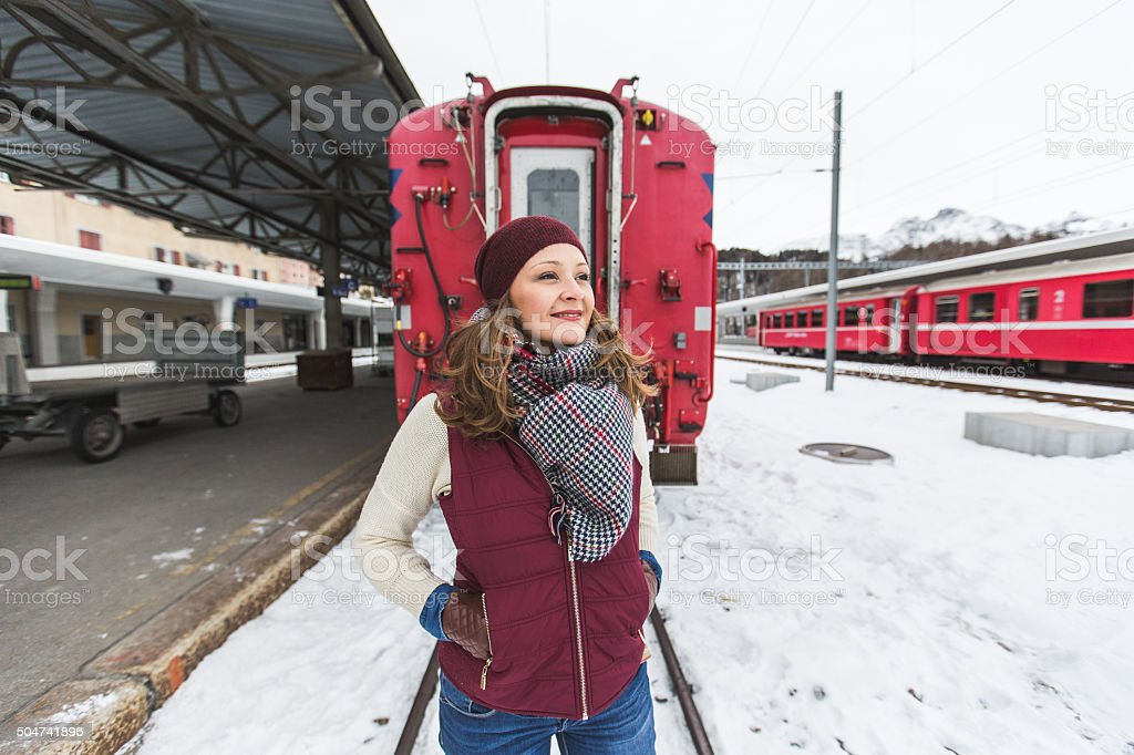 Beautiful young woman on train station stock photo