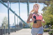 Beautiful young woman out running in the city  along the waterfront