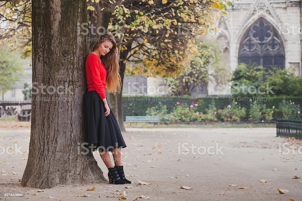 beautiful young woman outside stock photo