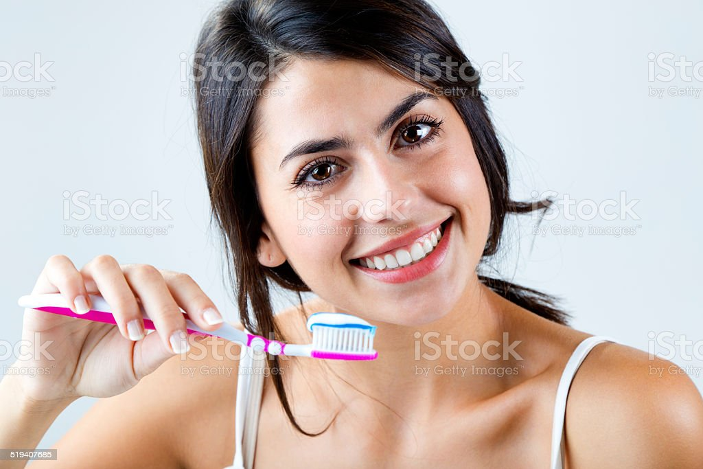 Beautiful young woman picking his teeth. stock photo