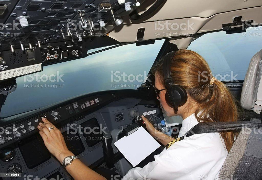 Beautiful young woman pilot at work stock photo
