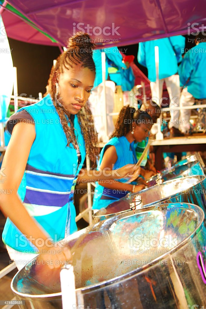 Beautiful young woman playing a steel drum stock photo