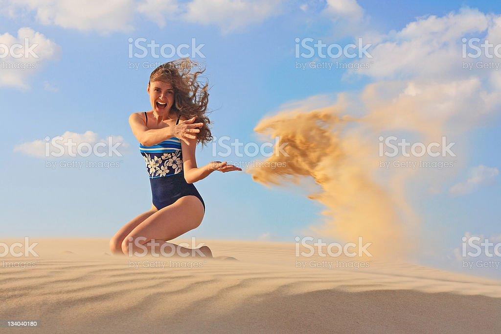 Beautiful young woman playing at  sunset beach royalty-free stock photo