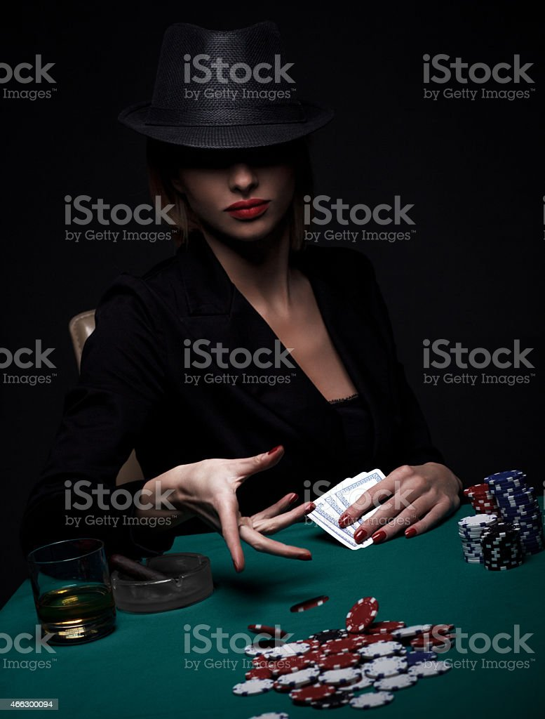 Beautiful young woman playing poker stock photo