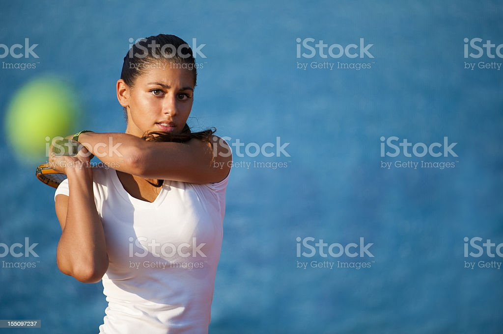 Beautiful young woman playing tennis royalty-free stock photo