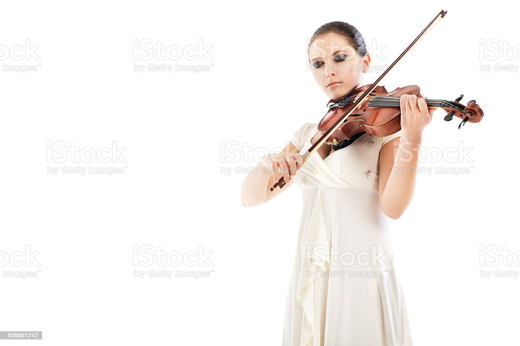 Beautiful young woman playing violin over white stock photo