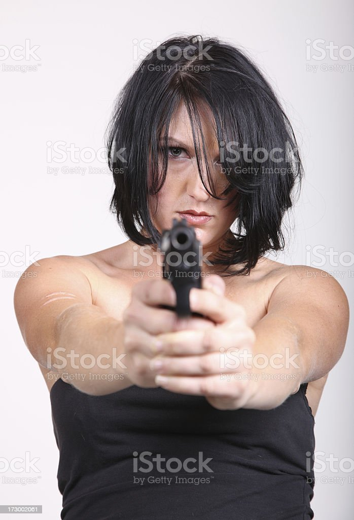 Beautiful Young Woman Pointing a Handgun royalty-free stock photo