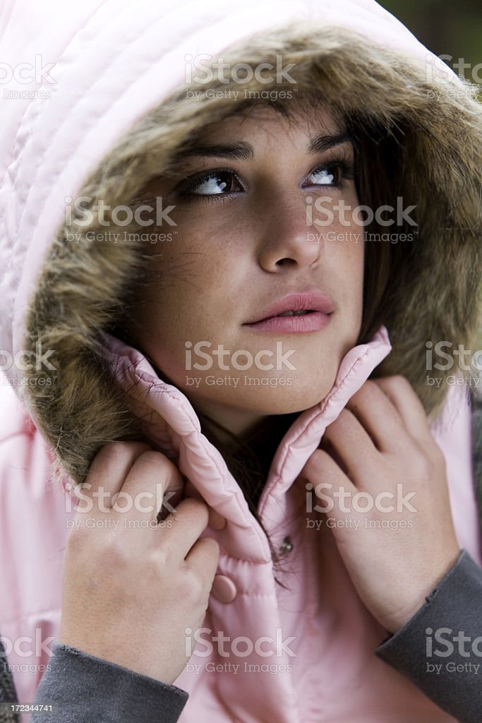 Beautiful Young Woman Portrait in Fur Lined Hooded Jacket royalty-free stock photo