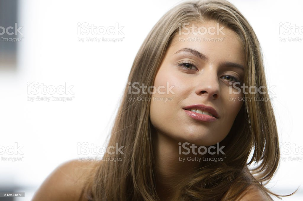 Beautiful young woman portrait smiling attractive blond stock photo