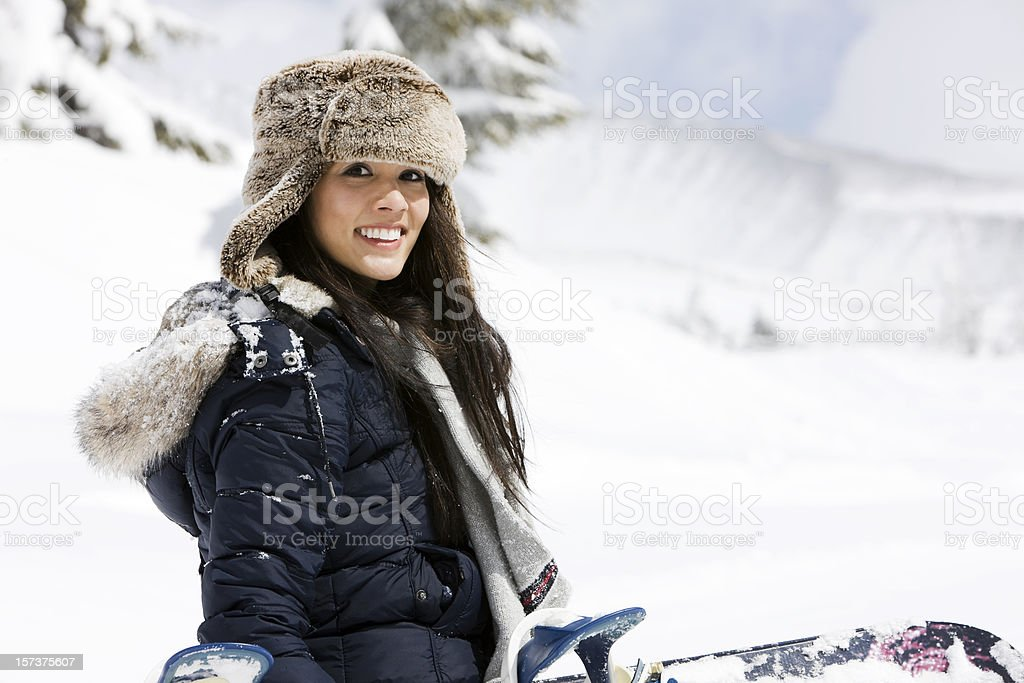 Beautiful Young Woman Portrait with Snowboard at Mountain, Copy Space royalty-free stock photo
