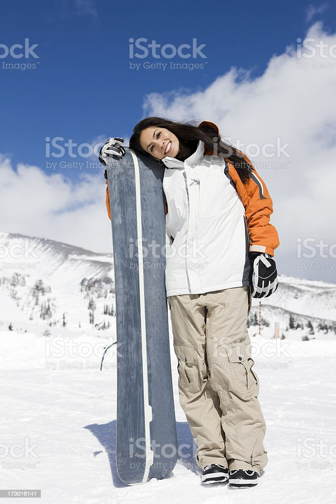 Beautiful Young Woman Portrait with Snowboard on Snowy Mountain, Copyspace royalty-free stock photo