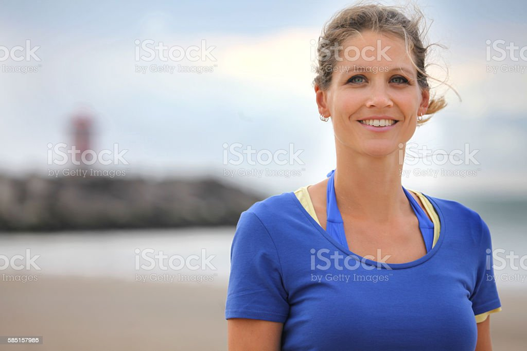 Beautiful young woman posing for beach photo in Summer stock photo