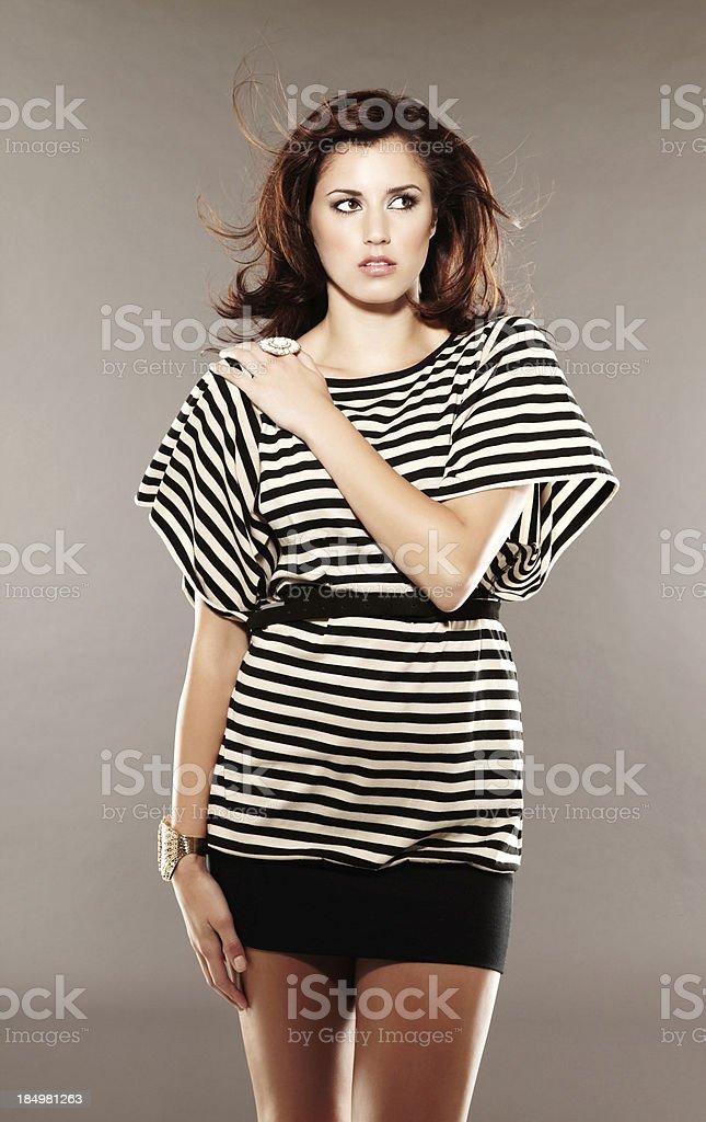 Beautiful young woman posing for camera loking away royalty-free stock photo