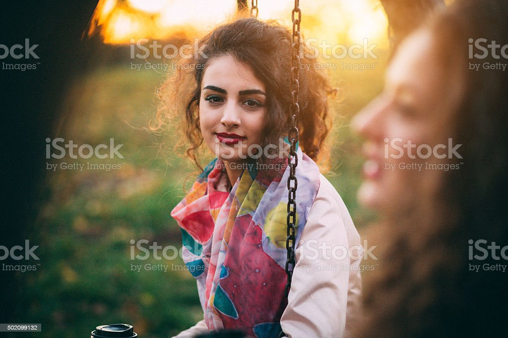Beautiful young woman posing in park stock photo